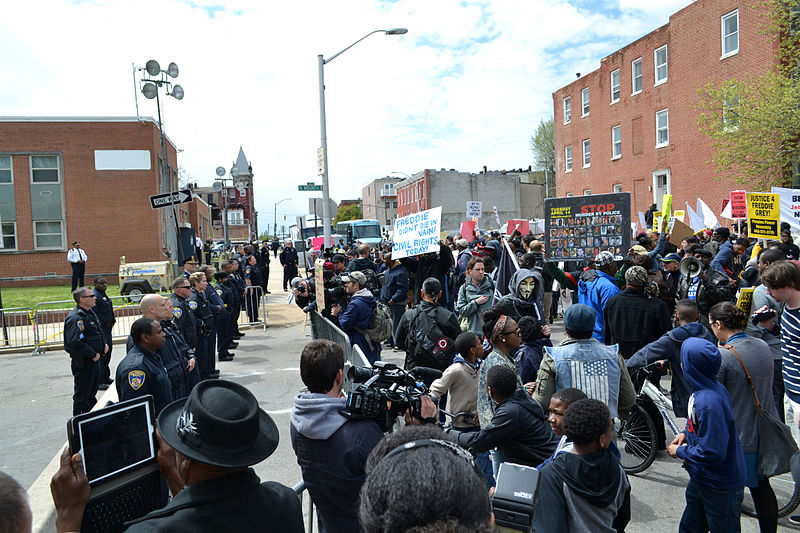 BALTIMORE, MD - April 25: Protest at the Baltimore Police Department Western District building at N. Mount St. and Riggs Ave. (Image credit: Veggies/Wikimedia Commons)
