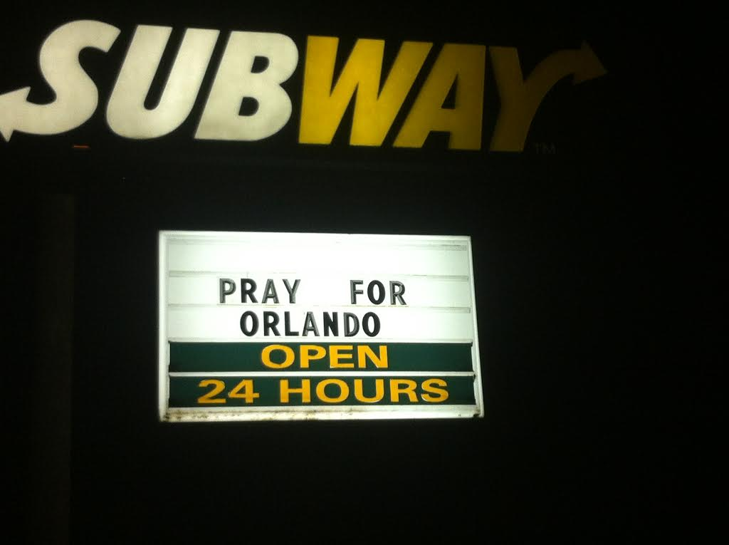 "ORLANDO, FL JUNE 12, 2016 - The Subway store near Pulse night club provided parking for some of the countless news trucks and added the words ""PRAY FOR ORLANDO"" to their sign.  Image credit: 1776 Channel"