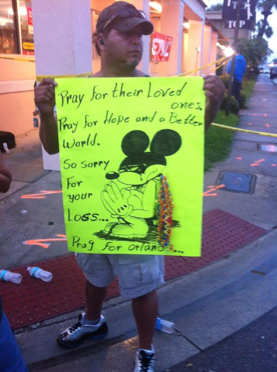 "ORLANDO, FL - JUNE 12, 2016 A sign reads ""Pray for Orlando"" and depicts a crying Disney Mickey Mouse.  Image credit: 1776 Channel"