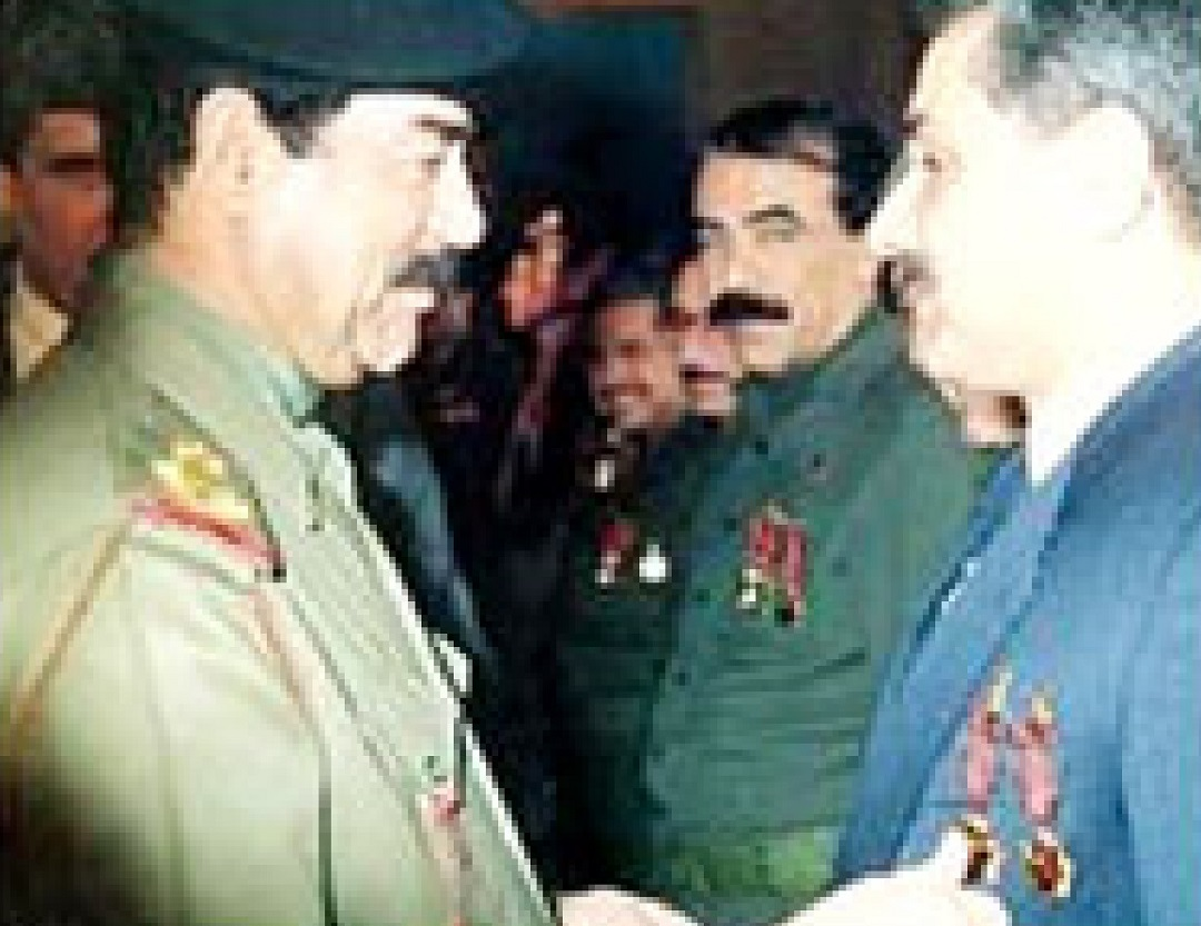 Iraqi dictator Saddam Hussein pins medals on the chest of nuclear physicist Dr. Jafar Dhia Jafar, the architect of Iraq's nuclear weapons program.